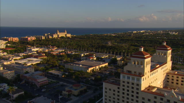LOW AERIAL Intercoastal Waterway, 'The Biltmore' and 'The Breakers' hotels and beach at Palm Beach, Florida, USA