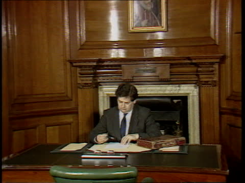 interest rate cut lms lawson at desk with budget box zoom in cs1/itn cms lawson downing st no 11 tms john major mp with wife next as holding up... - budget stock-videos und b-roll-filmmaterial