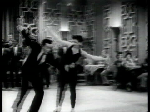 interest rates cut; lib location unknown b/w tms people dancing in rock and roll style in club as bill haley and the comets perform b/w ditto b/w tms... - b roll stock-videos und b-roll-filmmaterial