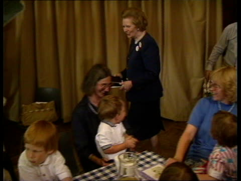 Interest Rates Up **** FOR ENGLAND London Mrs Margaret Thatcher talking at Tory womens conference on inflation Mrs Thatcher visits conference creche...