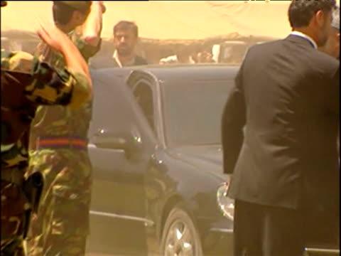 interim president hamid karzai gets out of car to greet uk troops preparing to leave afghanistan end of war in afghanistan 2002 - 2001年~ アフガニスタン紛争点の映像素材/bロール
