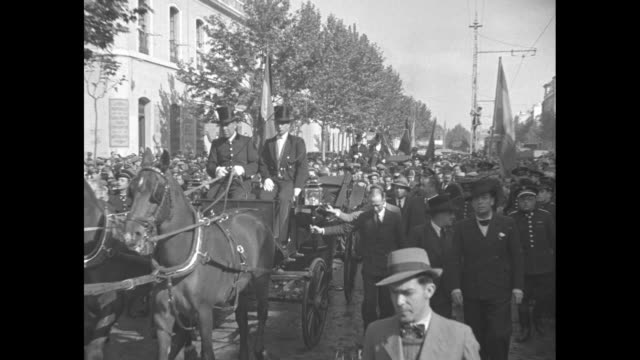 Interim President of Spain Diego MartinezBarrio parades through crowd in street seated in open carriage driven by liveried coachmen / Note exact...