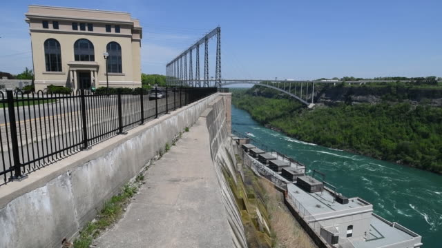 Interior and exterior clips of the Ontario Power Sir Adam Back hydropower generating station along the Niagara River downstream of Niagara Falls...