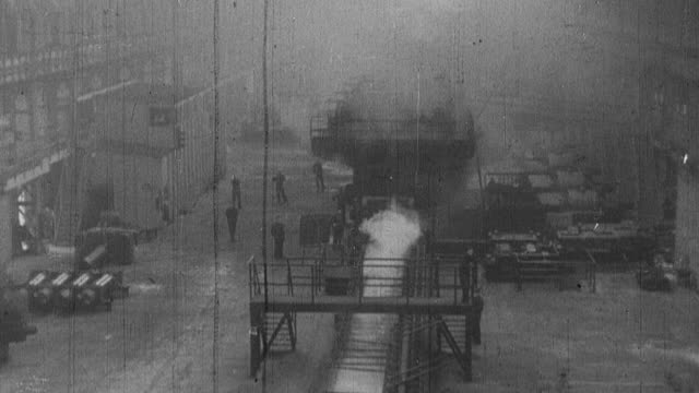 1939 montage interior and exterior of industrial factories in operation with factory pipes bellowing smoke / united kingdom - 1939 stock-videos und b-roll-filmmaterial