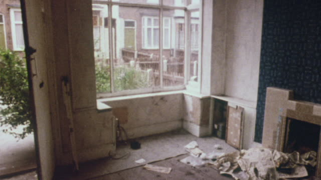 1980 montage interior and exterior of various antiquated houses in disrepair / aston, england, united kingdom - bad condition stock videos & royalty-free footage