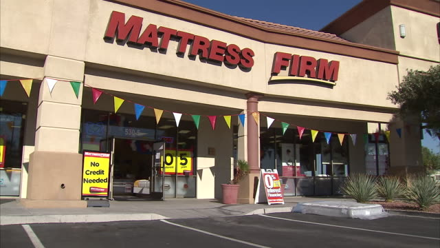 interior and exterior shots of a discount store selling matteresses as an employee carries mattresses out to the car park on 16 october 2013 in las... - mattress stock videos and b-roll footage