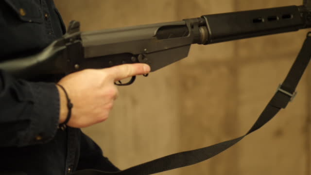 interior arty slow motion shots of people with rifles and handguns shooting at targets on a shooting range on march 23 2018 in st louis missouri - shooting range stock videos and b-roll footage