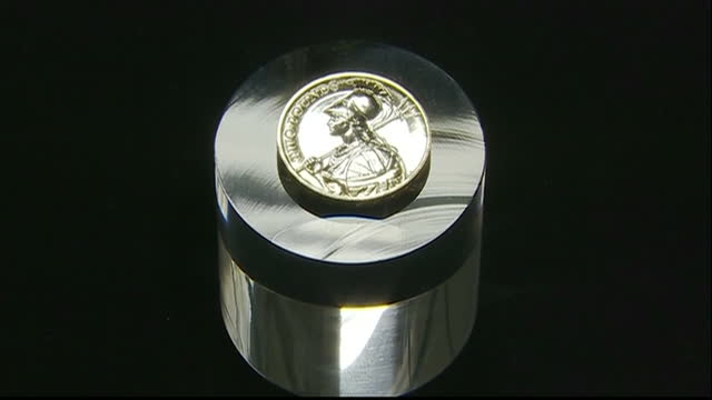 interior close up image of britannia on two pounds coin at royal mint interior shots david cameron prime minister looking at new coin designs at... - royal mint stock videos & royalty-free footage