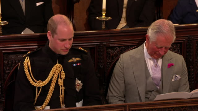 interior close up shot of prince charles sat next to prince william with his head down during the wedding ceremony of prince harry and meghan markle... - religious service stock videos & royalty-free footage