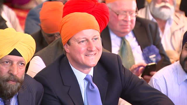 interior close up shots david cameron leader of conservative party prime minister wearing orange turban and wife samantha cameron samcam sat in guru... - turban stock videos & royalty-free footage