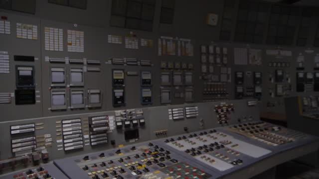 vidéos et rushes de interior close up shots moving over the control panel instruments in chernobyl reactor three control room, finishing at the az5 emergency shut down... - programme de télévision