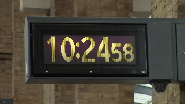 Interior close up shots of a digital clock and a classic analogue clock on display over a train platform at King's Cross station on 6th June 2018 in...