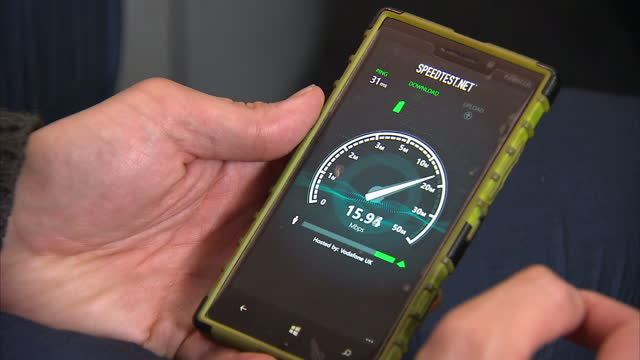 interior close up shots of broadband speeds being checked on a mobile phone on november 11, 2016 in london, united kingdom, - downloading stock videos & royalty-free footage