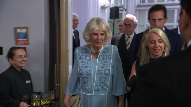 interior close up shots of camilla duchess of cornwall walking into room and being led to guests of the nhs heroes awards at london's park lane... - richard hammond stock videos & royalty-free footage