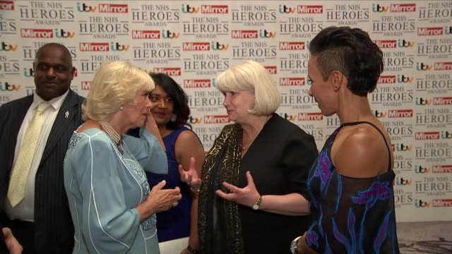 interior close up shots of camilla the duchess of cornwall meeting dame kelly holmes at the park lane hilton hotel for the nhs heroes awards on 14th... - richard hammond stock videos & royalty-free footage