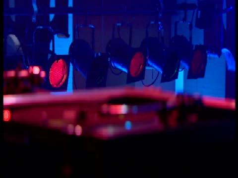 vídeos de stock, filmes e b-roll de interior close up shots of dj playing records interior close up shots of needle on record interior shots of clubbers dancing all music requires... - clubbing