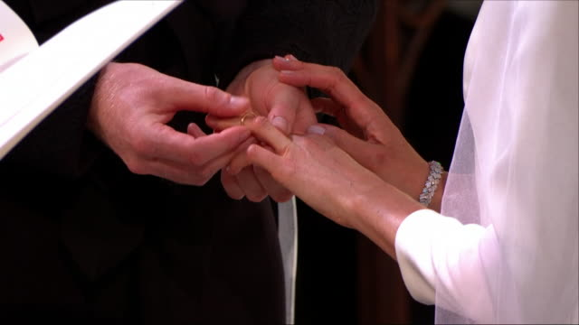 Interior close up shots of Prince Harry and Meghan Markle exchanging wedding rings during the wedding ceremony at St George's Chapel on 19th May 2018...