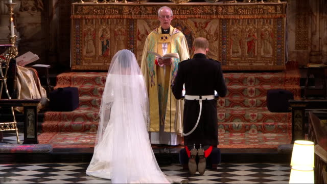 interior close up shots of prince harry and meghan markle kneel before the archbishop of canterbury and receive the blessing of the marriage from... - kneeling stock videos and b-roll footage