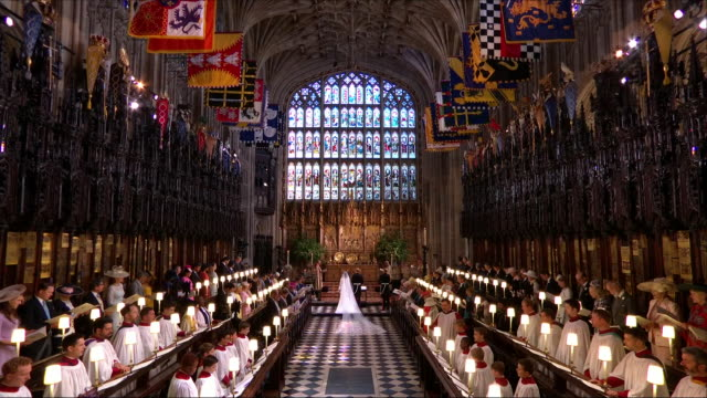 interior close up shots of prince harry and meghan markle singing during the wedding service including shots of members of the royal family singing... - queen royal person stock videos & royalty-free footage