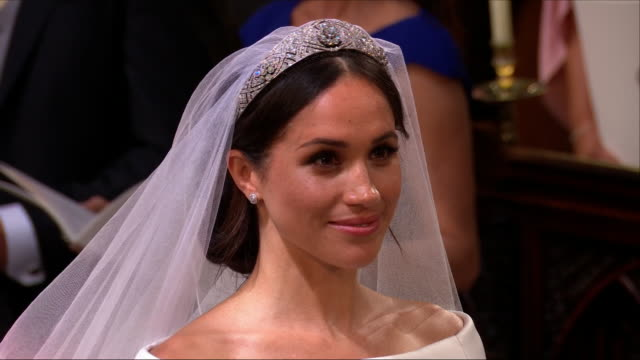 interior close up shots of prince harry and meghan markle smiling and chuckling as they give their declarations to love and honour each other... - archbishop stock videos & royalty-free footage