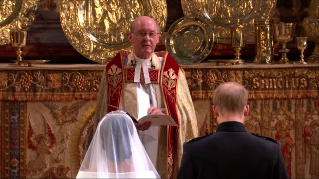 interior close up shots of prince harry and meghan markle stood at the alter holding hands at st george's chapel as the dean of windsor david conner... - queen royal person stock videos & royalty-free footage