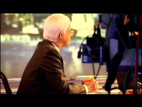 interior cut away shots alistair darling sat on the sky news set before an interview with adam boulton where he will outline some of his spending cut... - letterbox format stock videos & royalty-free footage