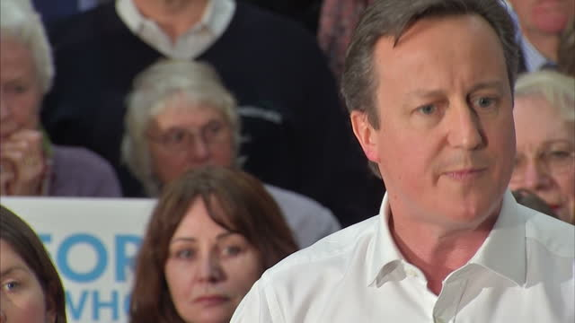 interior cutaway shots david cameron, prime minister on the campaign trail, giving speech at conservative party event in chippenham. on march 30,... - チッペナム点の映像素材/bロール