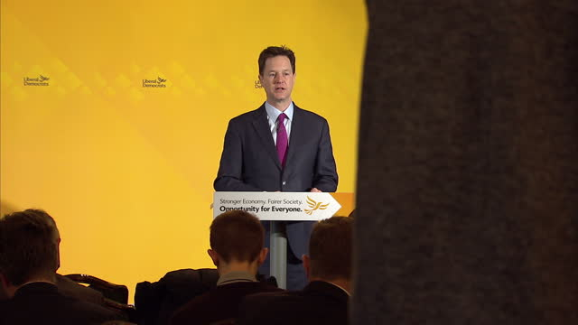 interior cutaway shots nick clegg liberal democrat leader giving speech launching the lib dem nhs manifesto on march 31 2015 in watford united kingdom - ニック クレッグ点の映像素材/bロール
