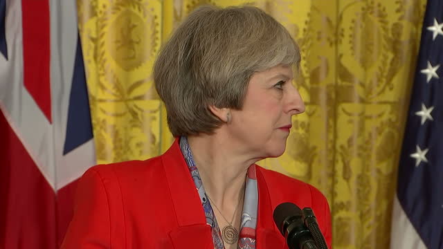 Interior cutaway shots of presser with Prime Minister Theresa May and President Donald Trump Theresa May listening and reacting as Trump speaks...