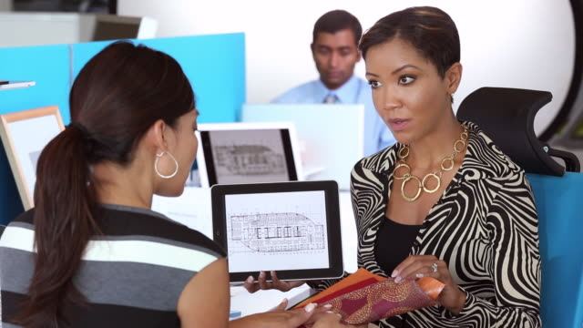 MS PAN Interior Designer and Architect Discussing Building Plans on Tablet Computer / Richmond, Virginia, USA