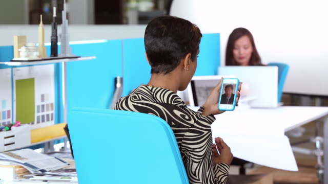 MS Interior Designer Discussing Plans While Video Conferencing on Smart Phone / Richmond, Virginia, USA