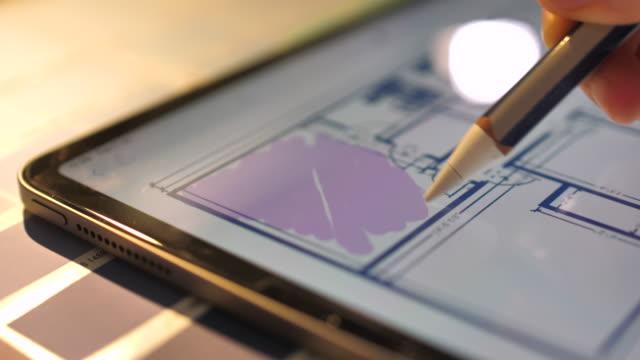 interior designer working on digital tablet - interior designer stock videos & royalty-free footage