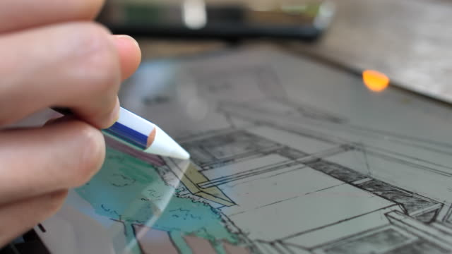 vídeos de stock e filmes b-roll de interior designer working on tablet trying out colors on a design with digital tablet - arquiteta