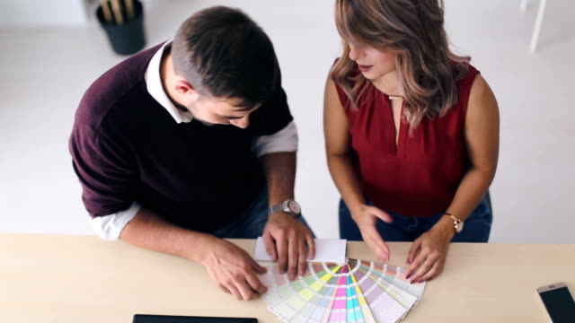 interior designers pointing at colour charts - color swatch stock videos & royalty-free footage