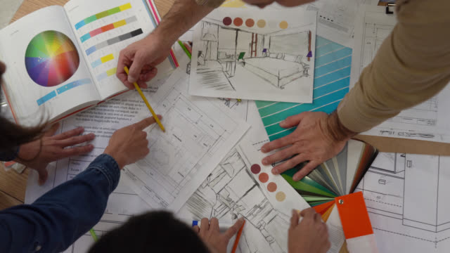 interior designers working together on a project looking at a color swatch and blueprints - retail display stock videos & royalty-free footage