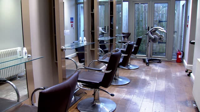 interior empty hair salon in cardiff, during coronavirus lockdown - hairstyle stock videos & royalty-free footage
