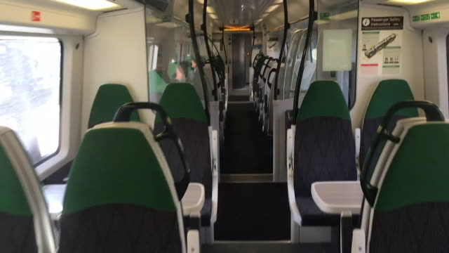 interior empty train coming into london during coronavirus lockdown - vehicle interior stock videos & royalty-free footage