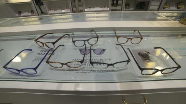 Interior footage of a Warby Parker lens store with many glasses on display on Greene street in New York NY on January 31 2017 Shots shot of several...