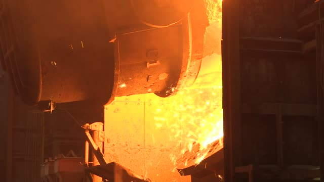 stockvideo's en b-roll-footage met interior footage of the united states steel corporation edgar thomson plant as steel is poured out of ladle in braddock pennsylvania on june 22 shots... - soeplepel