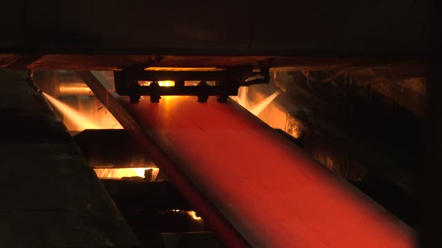 interior footage of the united states steel corporation edgar thomson plant as steel slabs are cut with gas in braddock pennsylvania on june 22 shots... - ペンシルベニア州点の映像素材/bロール