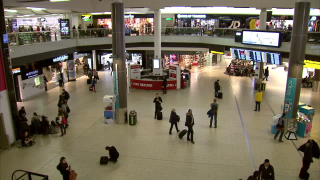 interior high shots passengers walking in gatwick airport terminal departure lounge on february 21, 2015 in london, england. - 2015 video stock e b–roll