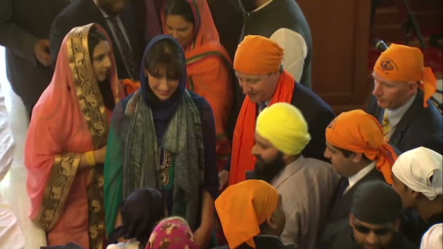 interior high shots prime minister david cameron leader of conservative party wearing small orange turban and wife samantha cameron wearing headscarf... - turban stock videos & royalty-free footage