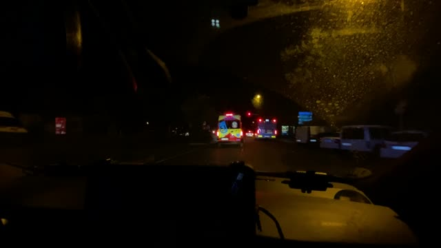 interior image of police car behind ambulance - spain stock videos & royalty-free footage