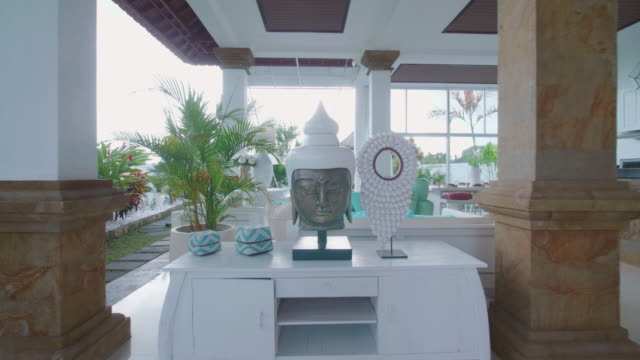 interior inside a villa resort hotel with a buddha head traveling in exotic tropical bali, indonesia. - ubud district stock videos & royalty-free footage