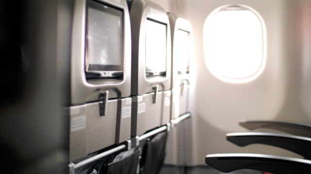 interior inside of airplane in cabin passenger , dolly shot - liquid crystal display stock videos & royalty-free footage