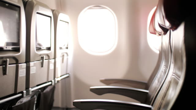 interior inside of airplane in cabin passenger , dolly shot - chair stock videos & royalty-free footage