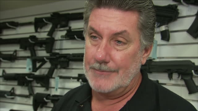 vídeos de stock e filmes b-roll de interior interview ed henson owner of stlucie shooting centre about how he felt when he heard the news about the shootings on june 14 2016 in fort... - homofobia