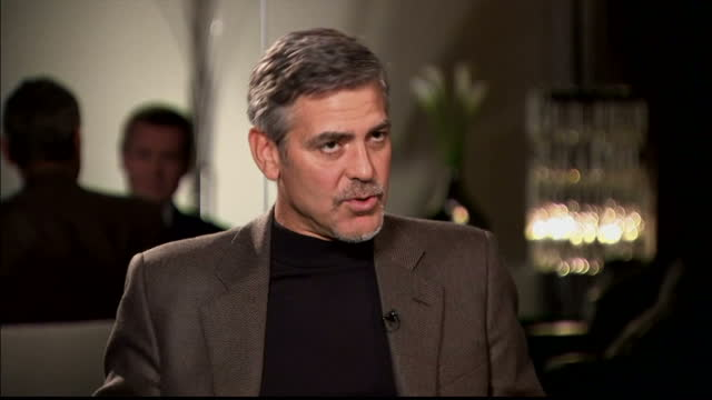 interior interview george clooney, actor on campaigning in sudan. the hollywood actor george clooney has been involved in aid projects in the region... - ジョージ・クルーニー点の映像素材/bロール