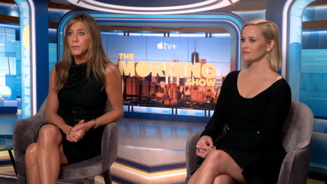 stockvideo's en b-roll-footage met interior interview with actors jennifer aniston and reece witherspoon speaking about the launch of their new drama the morning show and working in... - interview ruw materiaal