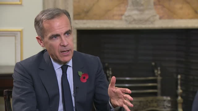 Interior interview with Bank of England Governor Mark Carney speaking about the bank's decision to raise interest rates from 025% to 05% in order to...
